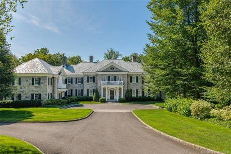 Luxury Mansion For Sale in Greenwich CT 06831. Big colonial, georgian house near waterfront with swimming pool and 7 car garage.