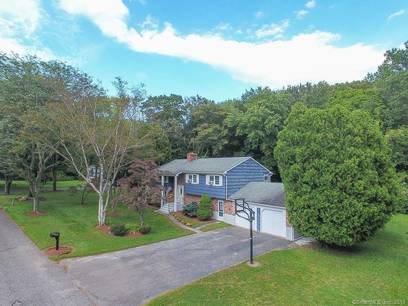 Single Family Home Sold in Monroe CT 06468. Ranch house near river side waterfront with swimming pool and 2 car garage.