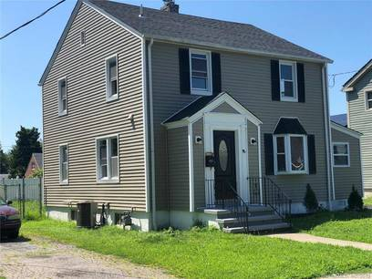 Single Family Home Sold in Bridgeport CT 06610. Colonial house near waterfront with 1 car garage.