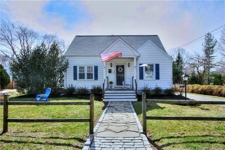 Single Family Home Sold in Fairfield CT 06824.  cape cod house near beach side waterfront with swimming pool and 2 car garage.
