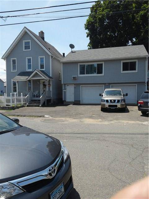 Multi Family Home Sold in Norwalk CT 06855. Old  house near beach side waterfront with 2 car garage.