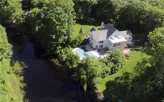 Single Family Home Sold in Ridgefield CT 06877. Tudor cape cod house near lake side waterfront with swimming pool and 2 car garage.
