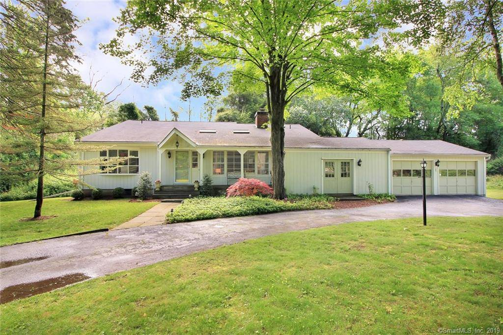 Single Family Home Sold in Fairfield CT 06824.  cape cod house near waterfront with 3 car garage.