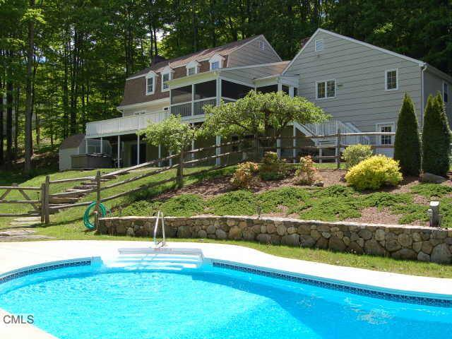 Single Family Home Sold in Redding CT 06896. Colonial house near waterfront with swimming pool and 2 car garage.