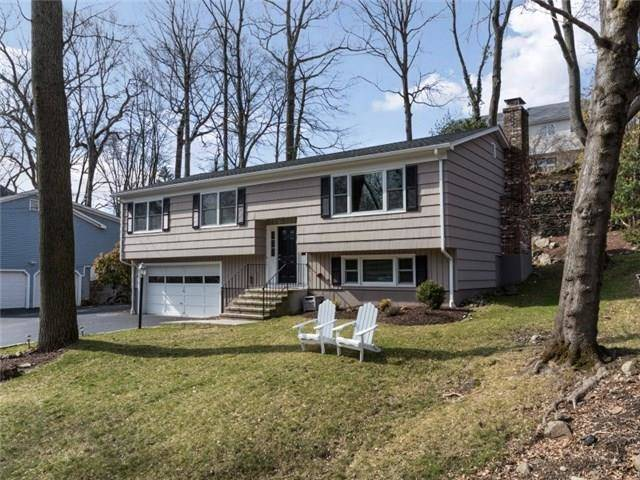 Single Family Home Sold in Fairfield CT 06824. Ranch house near river side waterfront with 2 car garage.