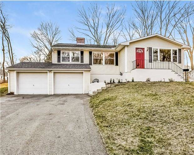 Single Family Home Sold in Fairfield CT 06825.  house near waterfront with 2 car garage.