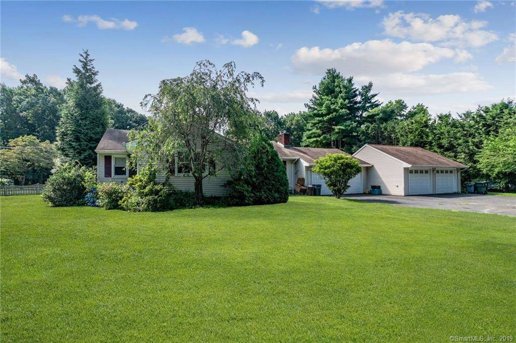 Single Family Home Sold in Fairfield CT 06825. Ranch house near beach side waterfront with 4 car garage.