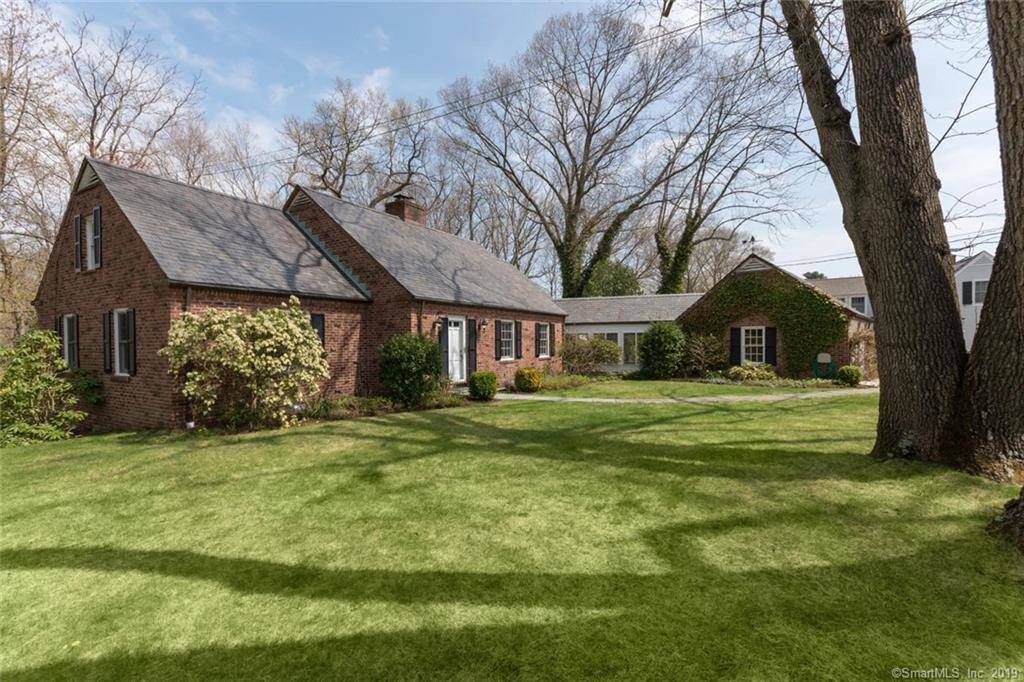 Single Family Home Sold in Darien CT 06820.  cottage house near beach side waterfront with 2 car garage.