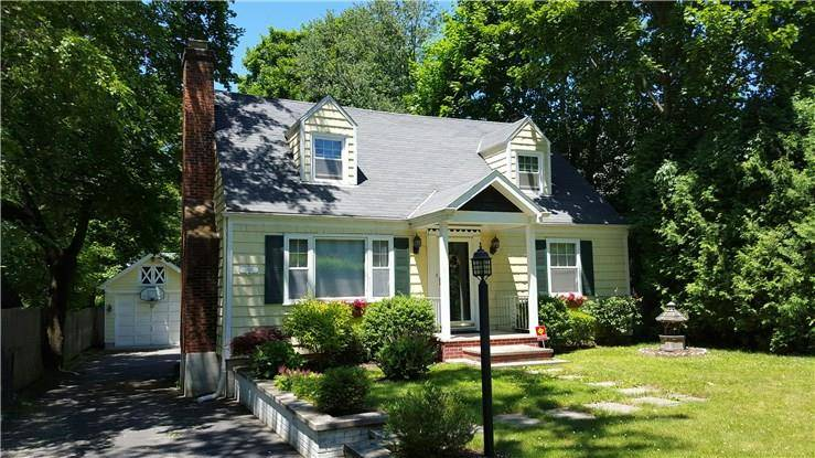 Single Family Home Sold in Darien CT 06820.  cape cod house near river side waterfront with 1 car garage.