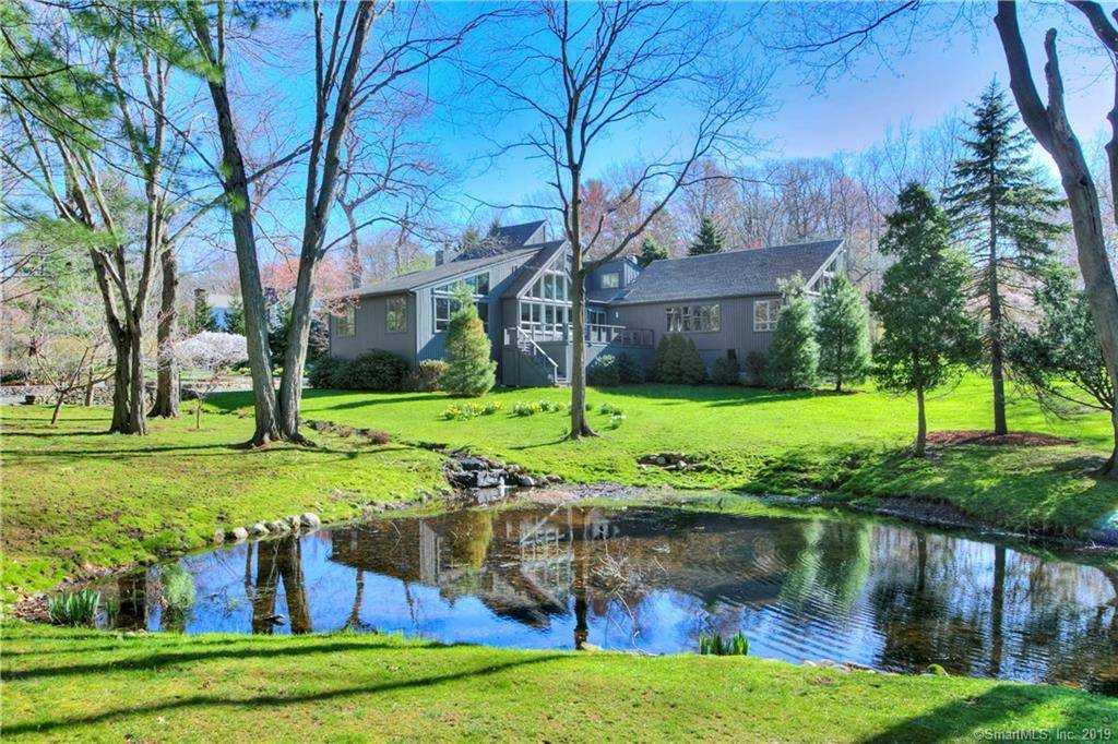 Single Family Home Sold in Westport CT 06880. Contemporary house near beach side waterfront with 4 car garage.