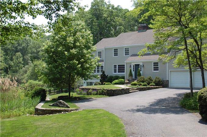 Single Family Home Sold in Wilton CT 06897. Colonial house near lake side waterfront with 2 car garage.