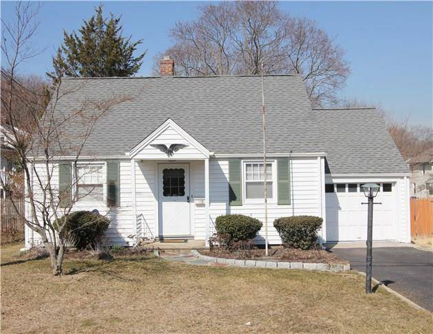 Single Family Home Sold in Norwalk CT 06850.  cape cod house near beach side waterfront with 1 car garage.