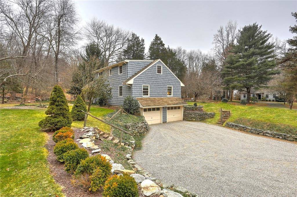 Single Family Home Sold in Fairfield CT 06824.  cape cod house near waterfront with 2 car garage.