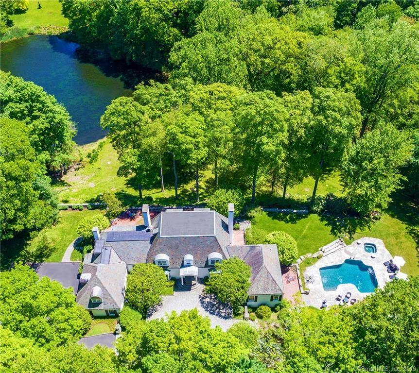 Luxury Mansion Sold in Greenwich CT 06831. Big colonial house near lake side waterfront with swimming pool and 3 car garage.
