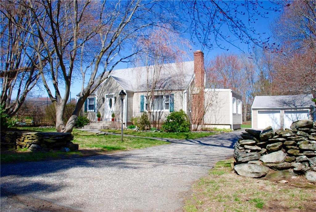 Single Family Home Sold in Fairfield CT 06825.  cape cod house near beach side waterfront with 2 car garage.