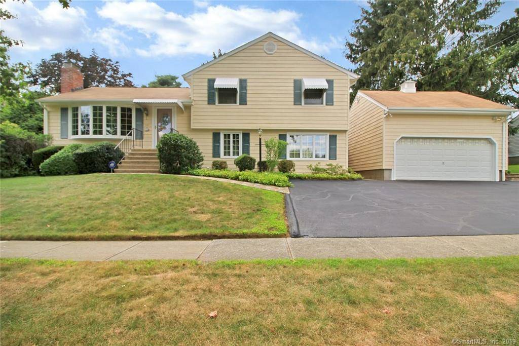 Single Family Home Sold in Stratford CT 06614.  house near beach side waterfront with swimming pool and 2 car garage.