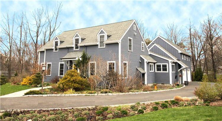 Single Family Home Sold in Ridgefield CT 06877. Colonial cape cod house near waterfront with 2 car garage.