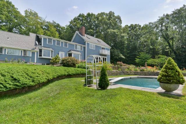 Single Family Home Sold in Wilton CT 06897. Contemporary, colonial house near lake side waterfront with swimming pool and 4 car garage.