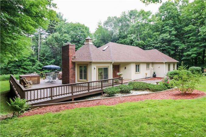 Single Family Home Sold in Monroe CT 06468. Contemporary, mediterranean house near waterfront with 2 car garage.