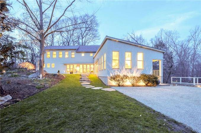 Luxury Single Family Home Sold in Darien CT 06820. Contemporary house near beach side waterfront with 2 car garage.