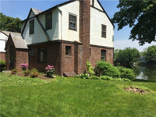 Single Family Home Sold in Greenwich CT 06807. Old colonial, tudor house near waterfront with 2 car garage.