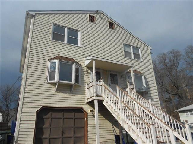 Foreclosure: Single Family Home Sold in Bridgeport CT 06606.  house near waterfront with 1 car garage.