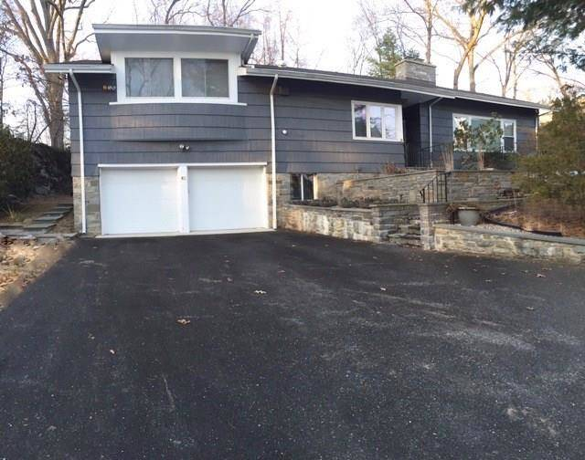 Single Family Home Sold in Fairfield CT 06825.  house near beach side waterfront with 2 car garage.