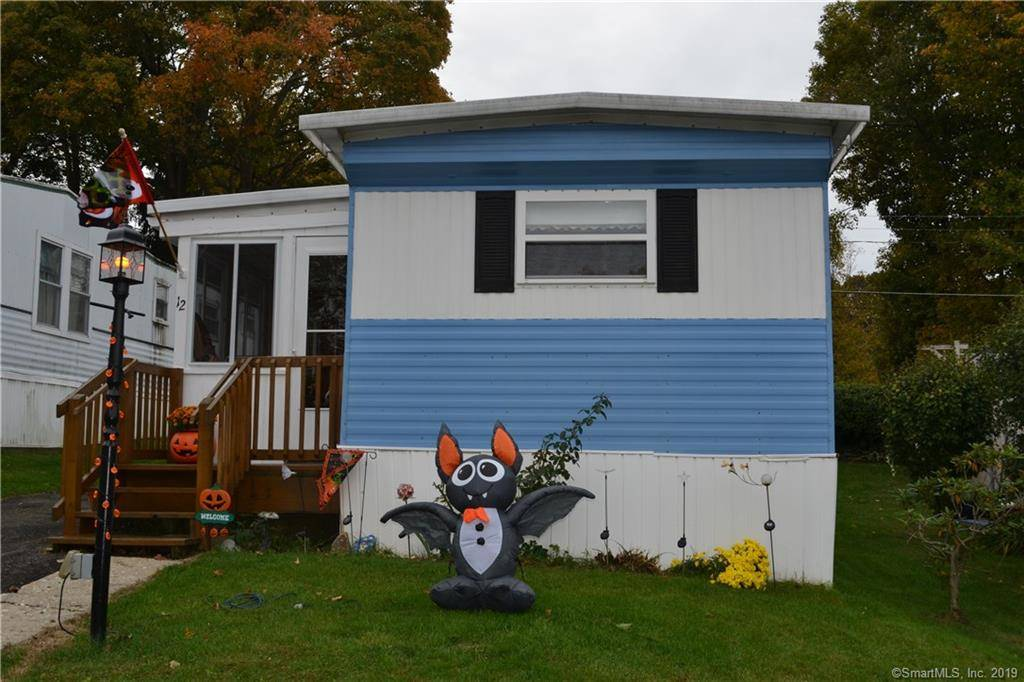 Single Family Home Sold in Danbury CT 06810.  mobile-home house near waterfront with 2 car garage.