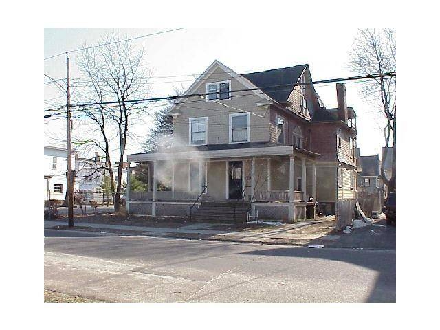 Short Sale: Multi Family Home Sold in Bridgeport CT 06605. Old  house near beach side waterfront with 1 car garage.