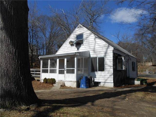 Foreclosure: Single Family Home Sold in Bridgeport CT 06610.  cape cod house near waterfront with 1 car garage.