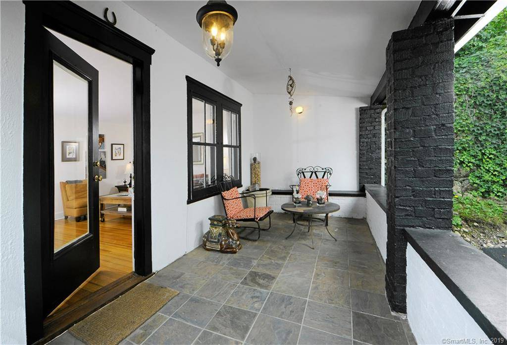 Single Family Home Sold in Greenwich CT 06807. Old  bungalow, cottage house near waterfront with 1 car garage.