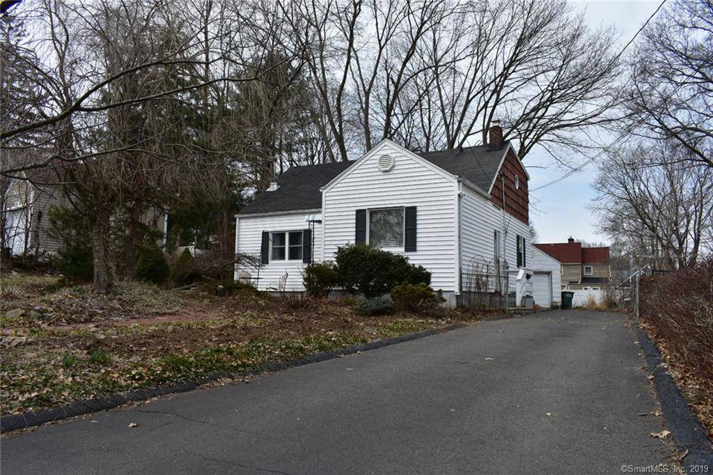Single Family Home Sold in Bridgeport CT 06610.  cape cod house near waterfront with 1 car garage.