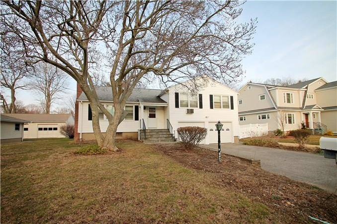 Single Family Home Sold in Fairfield CT 06824.  house near waterfront with 2 car garage.