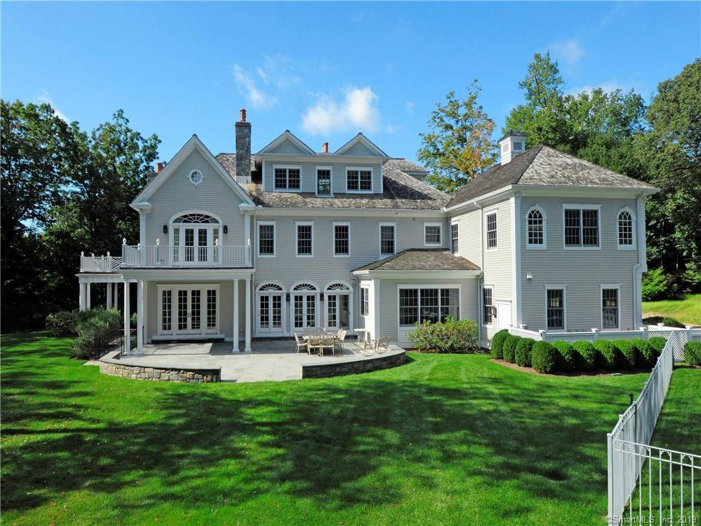 Luxury Mansion Sold in Greenwich CT 06830. Big colonial, georgian house near beach side waterfront with swimming pool and 3 car garage.
