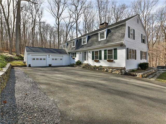 Single Family Home Sold in Redding CT 06896. Colonial house near waterfront with 6 car garage.