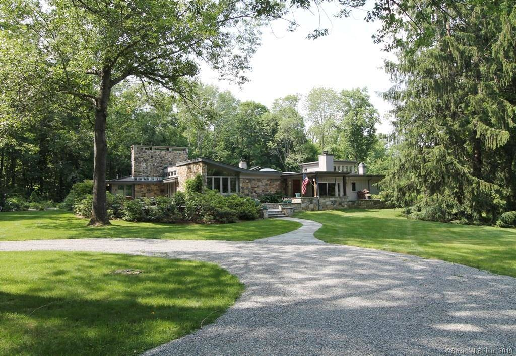 Single Family Home Sold in Redding CT 06896. Contemporary house near waterfront with swimming pool and 2 car garage.