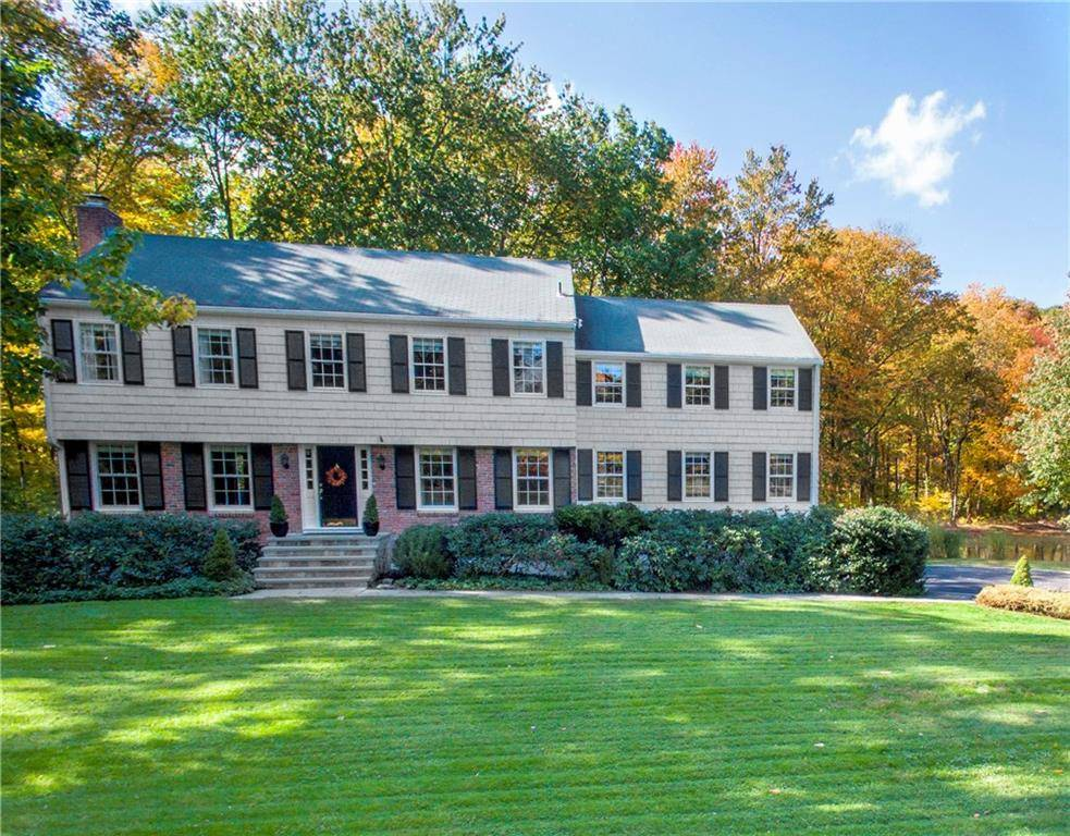 Single Family Home Sold in New Canaan CT 06840. Colonial house near lake side waterfront with 2 car garage.