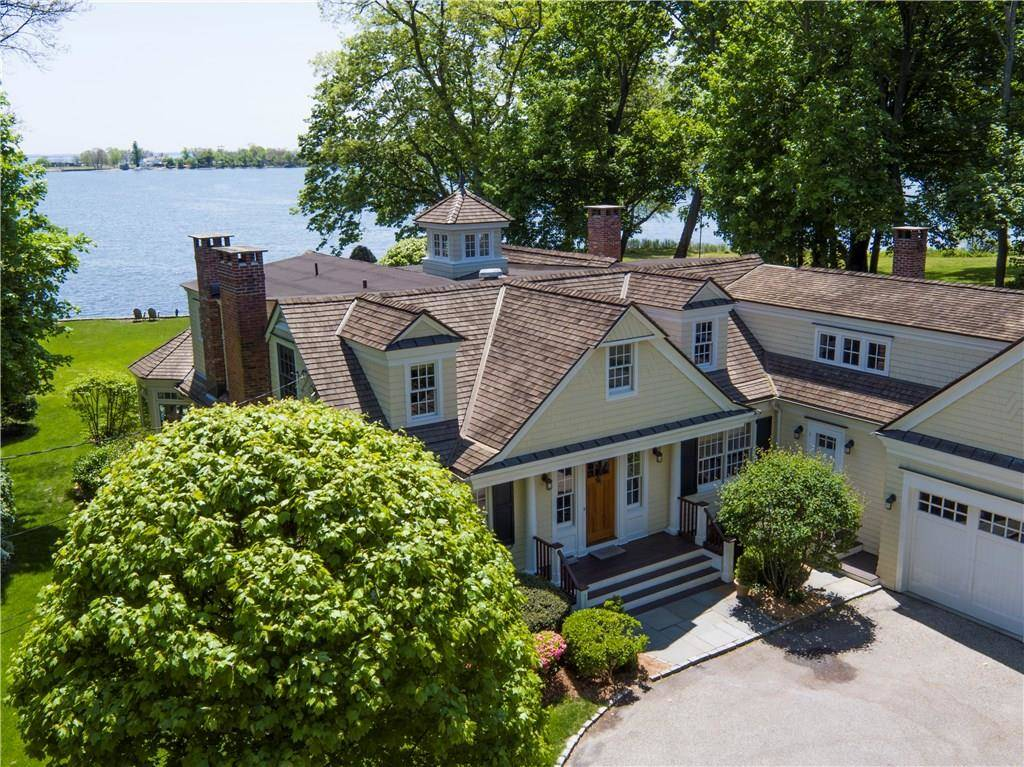 Luxury Single Family Home Sold in Darien CT 06820. Colonial house near lake side waterfront with 2 car garage.