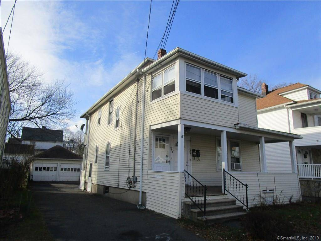 Multi Family Home Sold in Bridgeport CT 06606. Old  house near beach side waterfront with 2 car garage.